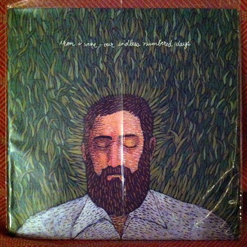 Album cover, sleeved, featuring an impressionist illustration of the bust of a bearded man on a field of grass